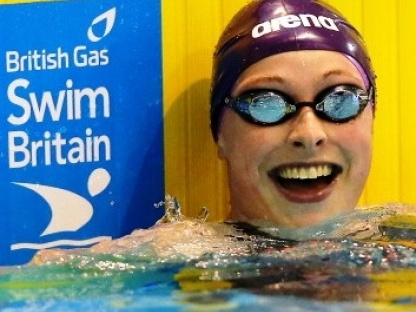 RACHEL KELLY GLASGOW, SCOTLAND - APRIL 11:  Rachael Kelly reacts after winning the Women's 100m Butterfly Final on day two of the British Gas Swimming Championships 2014 at Tollcross International Swimming Centre on April 11, 2014 in Glasgow, Scotland.  (Photo by Clive Rose/Getty Images)