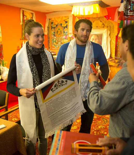 Olympic gold medal swimmer Natalie Coughlin, left, and her husband Ethan Hall receive a Tibetan flag as they tour the Tibetan Community Center, Wednesday, March 27, 2013 in Richmond, Calif. Coughlin spoke about her experiences competing in the Olympics, and answered questions from the audience. (D. Ross Cameron/Staff)